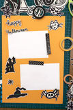 Halloween Scrapbook layout. A vertical overhead view of a Halloween scrapbook layout with decorations and the materials needed Royalty Free Stock Photos