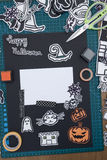 Halloween Scrapbook layout. A vertical overhead view of a Halloween scrapbook layout with decorations and the materials needed Stock Photography