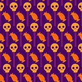 Halloween seamless pattern with candies and skull. On a background with dots Stock Image