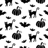Halloween seamless pattern with cats, pumpkins and bats Royalty Free Stock Image