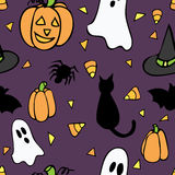 Halloween Seamless Pattern. A cute seamless pattern of Halloween themed items on a purple background Stock Illustration