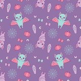 Halloween seamless pattern with cute violet and blue cartoon bats, spiderwebs, ribbons, pumpkins and eyeballs on purple background
