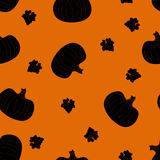 Halloween seamless pattern with dark pumpkins. On a orange background Stock Photography