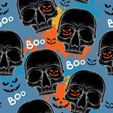 Halloween seamless pattern with dotted skulls in black and colorful blots Stock Images