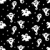 Halloween seamless pattern with hand drawn white ghosts doodles on black background Stock Images