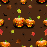 Halloween seamless pattern illustration with pumpkins scary faces and autumn leaves on dark background. Stock Images
