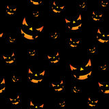Halloween seamless pattern illustration with pumpkins scary faces on black background. Stock Photos