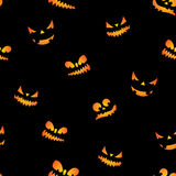 Halloween seamless pattern illustration with pumpkins scary faces on black background. Stock Photography