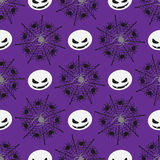 Halloween seamless pattern. Illustration of silhouettes of grinning ghost, webs with spiders on violet background stock illustration
