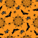 Halloween seamless pattern. Illustrations of silhouettes of bats, skulls, webs with spiders Royalty Free Stock Photography