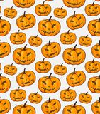 Halloween Seamless Pattern Isolated Wrap Wallpaper With Terrible Pumpkins In A Cartoon Style. Vector illustration of Stock Photo