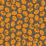 Halloween seamless pattern with pumpkin on dark background Stock Images