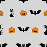Halloween seamless pattern with pumpkins, black cat and bat Stock Photography