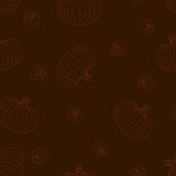 Halloween seamless pattern with pumpkins. On a dark background Royalty Free Stock Photos