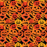 Halloween seamless pattern with pumpkins faces - d Royalty Free Stock Photography