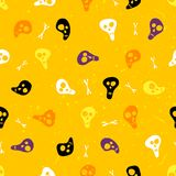 Halloween seamless pattern with skulls and bones. Stock Image