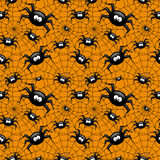 Halloween seamless pattern with spider and spiders web over oran Stock Photography