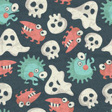 Halloween seamless pattern with spooky monsters, ghosts and skulls Royalty Free Stock Photos