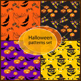 Halloween seamless patterns set with hats, pumpkins, bats. Halloween seamless patterns set with hats, pumpkins, bats, spiders and words Happy Halloween Royalty Free Stock Photos