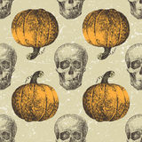 Halloween seamless with sculls and pumpkins Stock Image