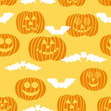 Halloween seamless texture with pumpkin and bats Stock Images