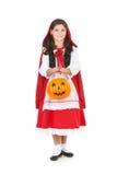 Halloween: Secchio della zucca della tenuta per gli ossequi Fotografie Stock Libere da Diritti