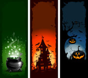 Halloween. Set of Halloween night backgrounds with pumpkin, haunted house and magic cauldron Stock Image