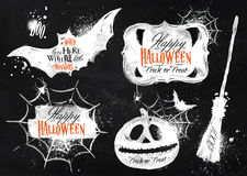 Halloween set symbols lettering in chalk. Halloween set, drawn halloween symbols pumpkin, lettering and stylized drawing with chalk on blackboard Royalty Free Stock Photo