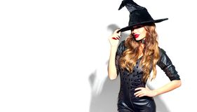 Free Halloween Sexy Girl Wearing Witch Costume With A Hat. Party, Celebrating. Beauty Woman With Long Hair And Holiday Bright Makeup Royalty Free Stock Photos - 159144268