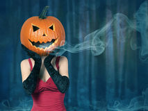 Halloween. Sexy lady with big pumpkin on head Stock Photography