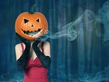 Halloween. lady with big pumpkin on head Stock Photography
