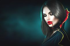 Halloween. Sexy vampire woman with dripping blood Royalty Free Stock Image
