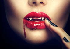 Halloween. Sexy vampire woman lips. With blood Royalty Free Stock Photo