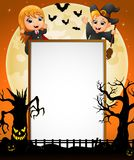 Halloween sign with little girl dracula and little boy witch and spooky tree Royalty Free Stock Images