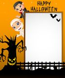 Halloween sign with little mummy and little boy dracula while waving hand and scary tree Stock Image