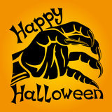 Halloween sign with werewolf`s hand. Halloween sign with werewolf`s hand on an orange background Royalty Free Stock Image
