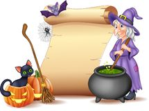 Halloween sign with witch stirring magic potion royalty free stock photo