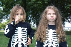 Halloween skeletons. Little girls dressed as a sketeton makie faces Royalty Free Stock Photo