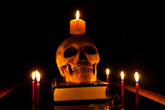 Halloween skull. Image with burning red candle Royalty Free Stock Photography