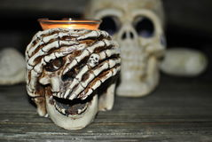 Halloween skull. Candle light in Halloween skull royalty free stock images