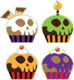 Halloween Skull Cupcakes. Decorative cupcakes with icing skulls for Halloween Stock Photos