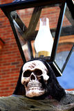 Halloween skull on lamp post Royalty Free Stock Images