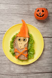 Halloween skull made of bread and vegetables. On plate and desk stock photography