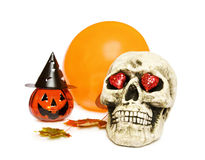 Halloween skull, pumpkin and balloon. Celebrating Halloween love with creepy skull, pumpkin decoration and balloon. Isolated on white background royalty free stock photography