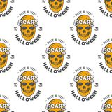 Halloween skulls seamless pattern with holiday wish typography. Scary halloween wallpaper. Stock vector isolated on. White background. retro colors. Vintage Royalty Free Stock Photo