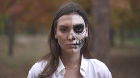Halloween. Smiling girl with scull makeup. Halloween. Smiling girl with scull make-up stock video footage