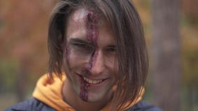 Halloween. Smiling guy with with a sinister make-up. Smiling guy with with a sinister make-up. Halloween holiday. All Saints` Night. Halloween concept. Best stock video