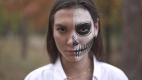 Halloween. Smiling woman with dead man makeup. Smiling Smiling woman with dead man makeup. Halloween holiday. All Saints` Night. Halloween concept. Best stock footage