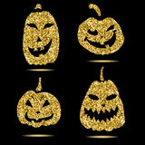 Halloween sparkley pumpkin with scary face on background Stock Photography