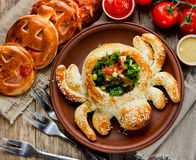 Halloween spider appetizer. Pizza dough baked spider vegetable s royalty free stock photography